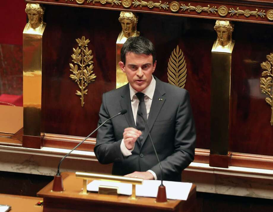 French prime minister Manuel Valls delivers his speech during an homage to the 17 victims of last week terrorist attacks, at the French national Assembly in Paris, Tuesday Jan. 13, 2015. (AP Photo/Remy de la Mauviniere) Photo: AP / AP