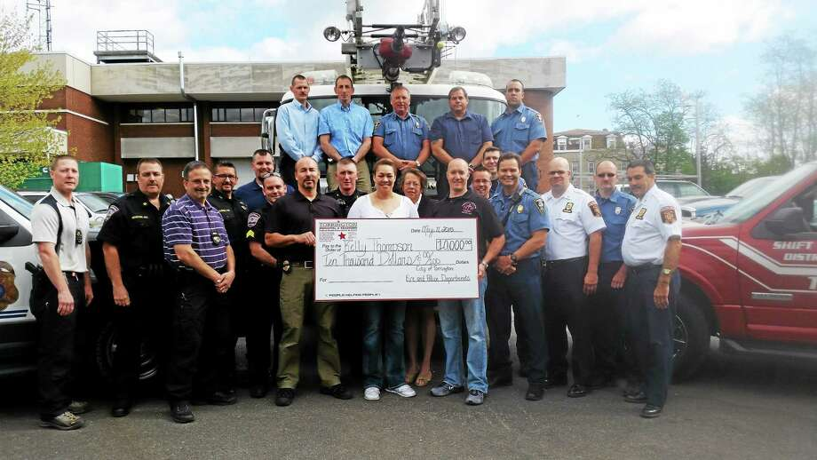 Kelly Thompson received a $10,000 check, all proceeds from a benfit dinner hosted by Torrington Firefighters Association Local 1567 and Torrington Police Local 442. Photo: Amanda Webster — The Register Citizen