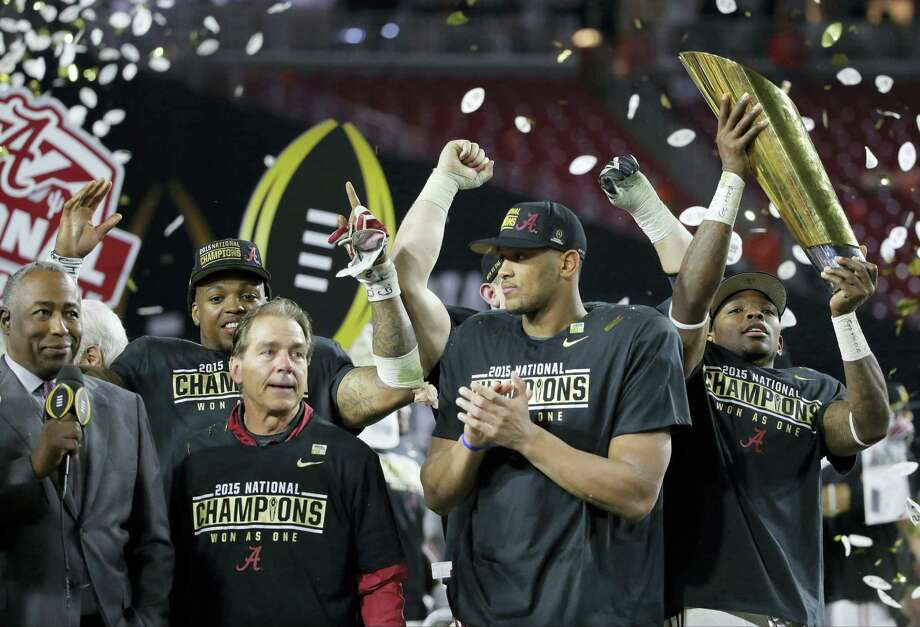 Alabama head coach Nick Saban, second from left, and players celebrate after the NCAA college football playoff championship game against Clemson Monday, Jan. 11, 2016, in Glendale, Ariz. Alabama won 45-40. (AP Photo/Chris Carlson) Photo: AP / AP
