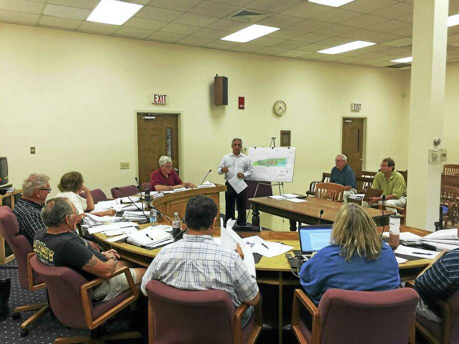 Rob Colabella of Lenard Engineering presents plans for a new Henny Penny gas station to the Winchester Planning and Zoning Commission Monday. Photo: Ben Lambert — The Register Citizen