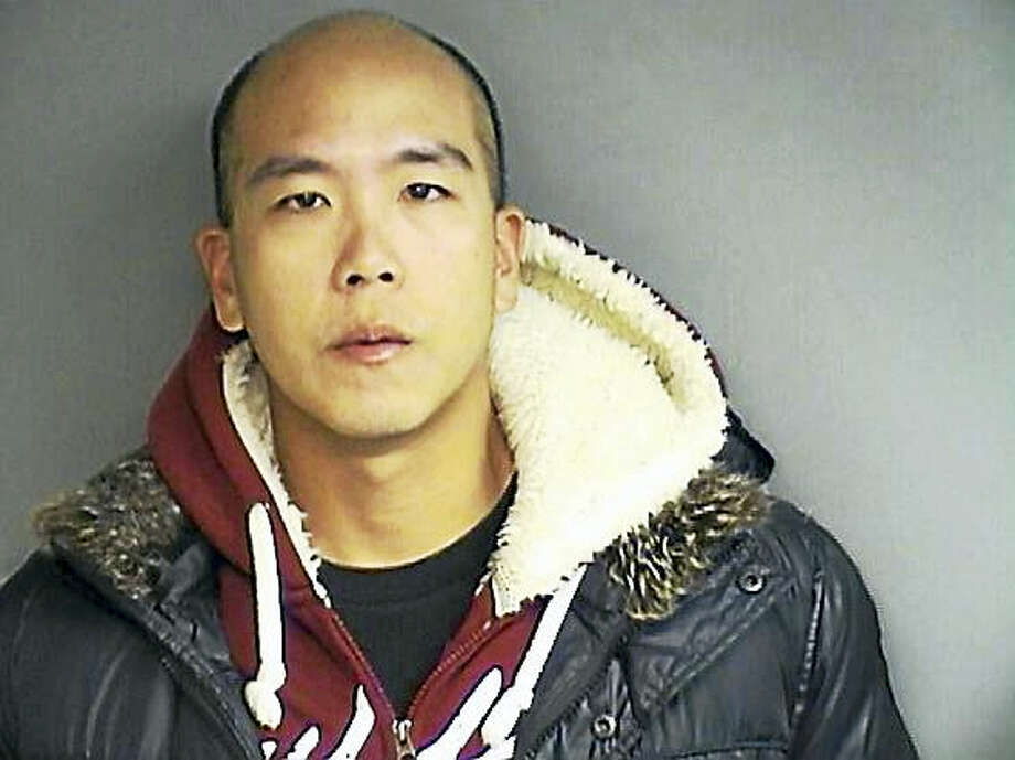 Screenshot via stamfordadvocate.com: Donald Chen, 30, of Queens, New York pleaded guilty to first-degree larceny for allegedly taking his police pay when he was supposed to be with the US Army Reserves, but enjoying a Hawaiian holiday with his girlfriend instead. Photo: Photo Courtesy Of Stamford Police Department