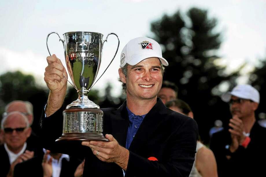 Kevin Streelman celebrates after winning the Travelers Championship last June at TPC River Highlands in Cromwell. Photo: Fred Beckham — The Associated Press File Photo  / FR153656 AP