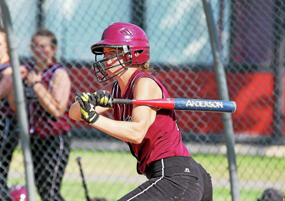 Brittany Anderson connects for her third home run in the Lady Raiders' win over Derby Tuesday afternoon at THS. Photo: Marianne Killackey — Register Citizen  / 2014