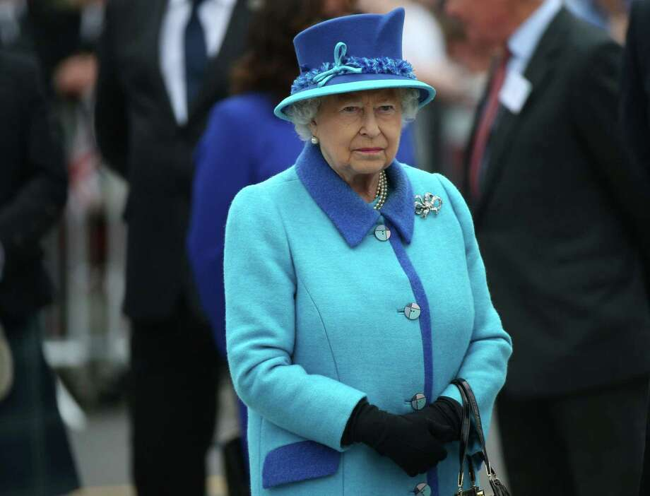 Britain's Queen Elizabeth II attends the opening ceremony for the Borders railway route at Tweedbank station, Scotland on Sept. 9, 2015. The Queen has become the longest ever reigning monarch in British history surpassing Queen Victoria who served for 63 years and seven months. Photo: AP Photo/Scott Heppell  / AP