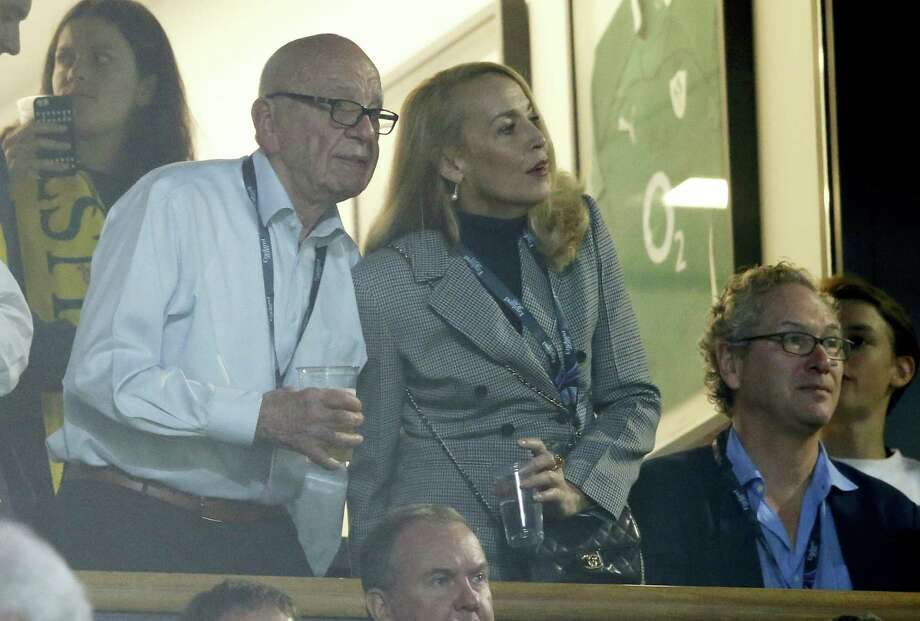In this Nov. 1, 2015, file photo, media mogul Rupert Murdoch stands with model Jerry Hall during the Rugby World Cup final between New Zealand and Australia at Twickenham Stadium, London. Murdoch has announced his engagement to Hall, the actress and former supermodel who had a long-time relationship with Mick Jagger, Monday, Jan. 11, 2016. Photo: AP Photo/Alastair Grant, File   / AP
