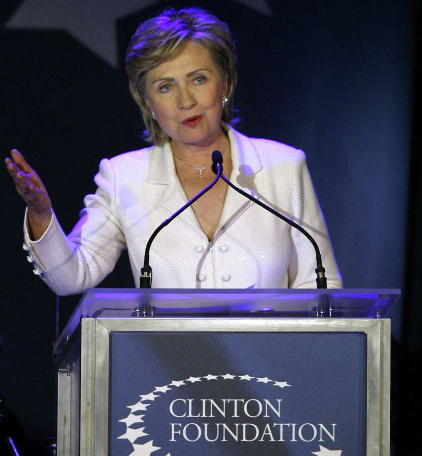 FILE - In this Oct. 28, 2006 file photo, then-Sen. Hillary Rodham Clinton, D-N.Y., speaks at a benefit gala for the Clinton Foundation at the American Museum of Natural History in New York.  The charitable foundation run by Hillary Rodham Clintonís family faces an uncertain future if she is elected president, with unresolved questions about who would be authorized to fundraise for the organization and whether new foreign and domestic projects could be started during that period.  (AP Photo/Jason DeCrow, File) Photo: AP / AP