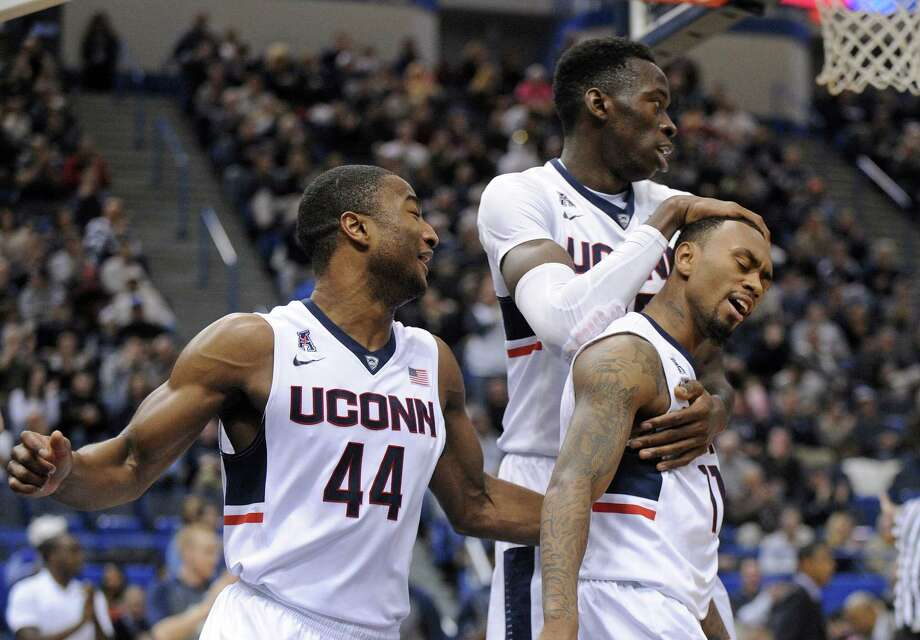 From left, Uconn's Rodney Purvis, Amida Brimah and Ryan Boatright. Photo: The Associated Press File Photo  / FR153656 AP