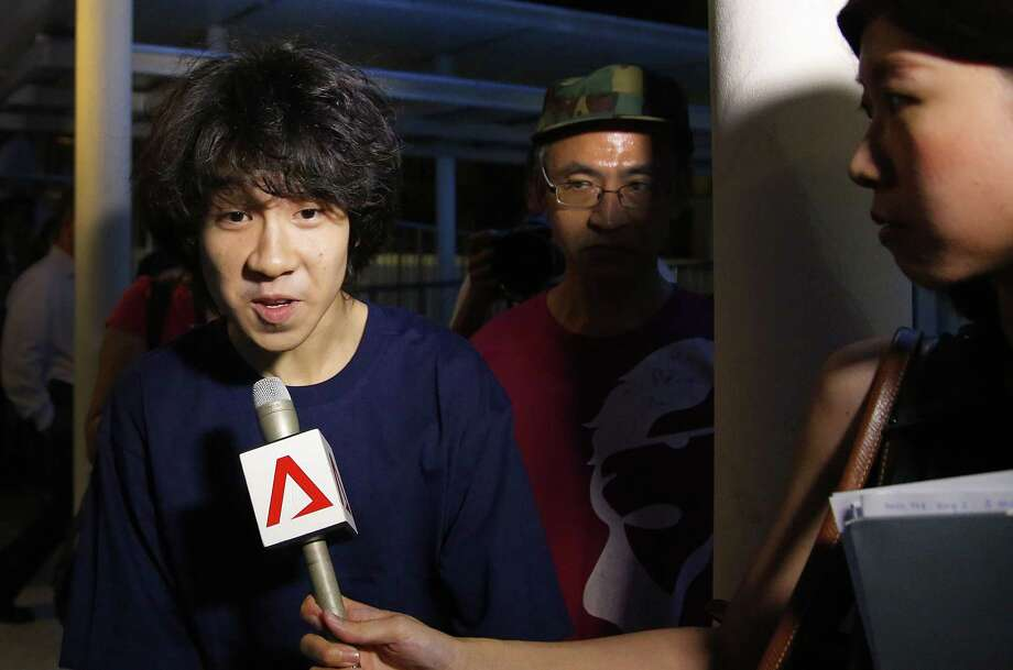 Singapore teen blogger Amos Yee, speaks to reporters while leaving the Subordinate Courts after being released on bail, Tuesday, May 12, 2015, in Singapore. Yee was found guilty of insulting Christians in a video monologue, and of distributing an obscene image of the country's founding father Lee Kuan Yew with former British leader Margaret Thatcher. The 16-year-old Yee faced three years in jail but instead will be put on probation. (AP Photo/Wong Maye-E) Photo: AP / AP