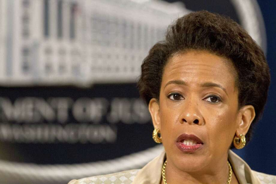 Attorney General Loretta Lynch announces a civil rights investigation of the Baltimore Police Department during a news conference at the Justice Department in Washington on May 8. Photo: AP Photo  / AP