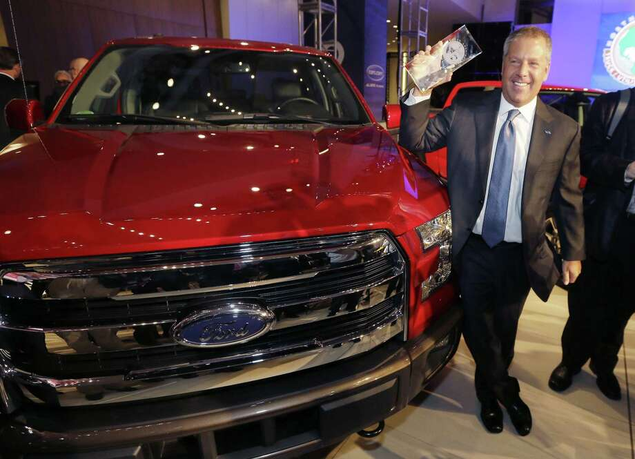 Joe Hinrichs, Ford executive vice president and president, the Americas, poses with the Ford F-150 truck after winning the North American Truck of the Year during the North American International Auto Show on Jan. 12, 2015 in Detroit. Photo: AP Photo/Carlos Osorio  / AP