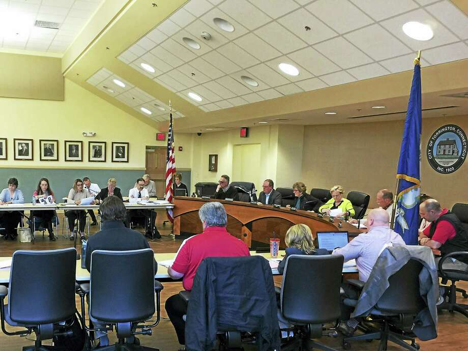 PHOTO BY BEN LAMBERTThe City Council, Board of Education and Board of Finance discuss how the proposed district budget would potentially be reduced to a zero-increase over last year Monday evening. Photo: Journal Register Co.