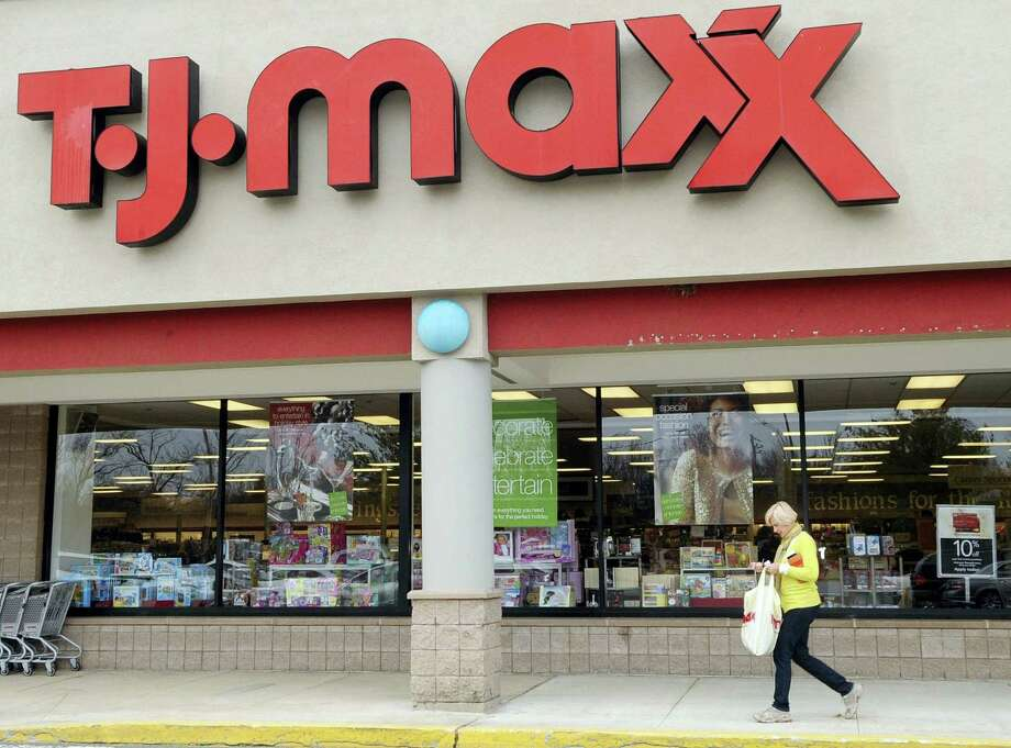 In this Nov. 17, 2009 photo, a customer walks past a T.J. Maxx store in Boston. Photo: AP Photo/Lisa Poole, File  / AP