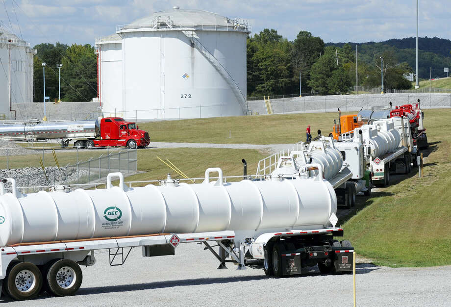 Tanker trucks line up at a Colonial Pipeline Co. facility in Pelham, Ala., near the scene of a 250,000-gallon gasoline spill on Friday, Sept. 16, 2016. The company says spilled gasoline is being taken to the storage facility for storage. Some motorists could pay a little more for gasoline in coming days because of delivery delays. Photo: AP Photo/Jay Reeves  / Copyright 2016 The Associated Press. All rights reserved.