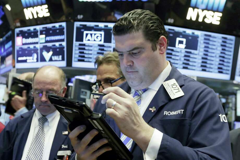 Trader Robert McQuade works on the floor of the New York Stock Exchange Tuesday. Photo: Richard Drew — The Associated Press  / Copyright 2016 The Associated Press. All rights reserved. This material may not be published, broadcast, rewritten or redistribu