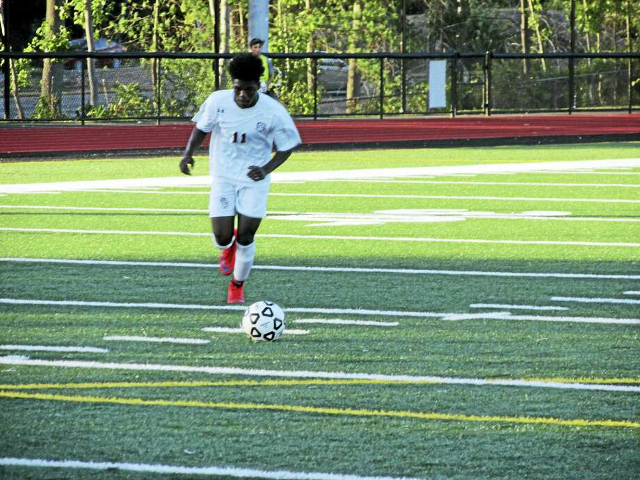 Torrington's Naseem Thompson embodies the speed and skill on this year's Red Raider team. Photo: Peter Wallace — Register Citizen
