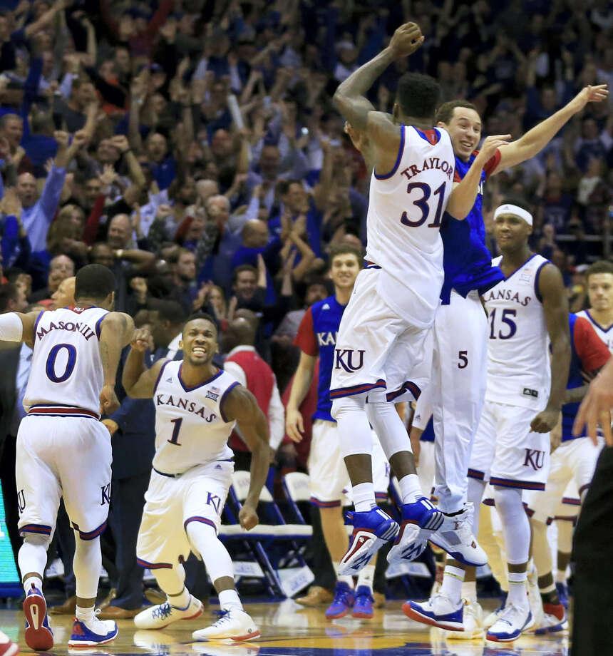 Kansas' Jamari Traylor (31) and Evan Manning leap into the air as Frank Mason III (0) and Wayne Selden Jr. (1) celebrate following their win over Oklahoma last week. Photo: The Associated Press  / AP