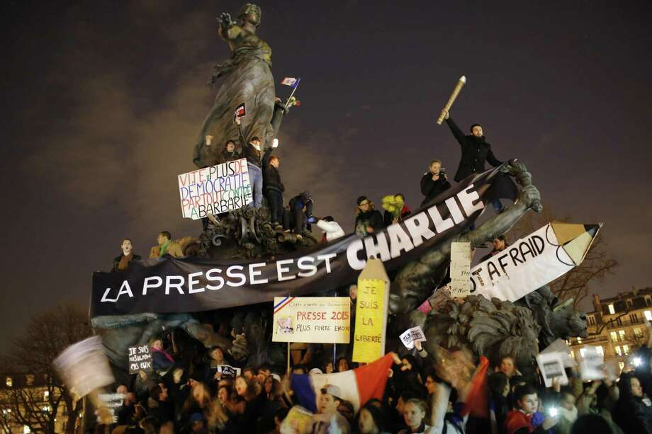 Hundreds of thousands of people marched through Paris on Sunday in a massive show of unity and defiance in the face of terrorism that killed 17 people in France's bleakest moment in half a century. Banner reads: Press is Charlie. Photo: Associated Press  / AP