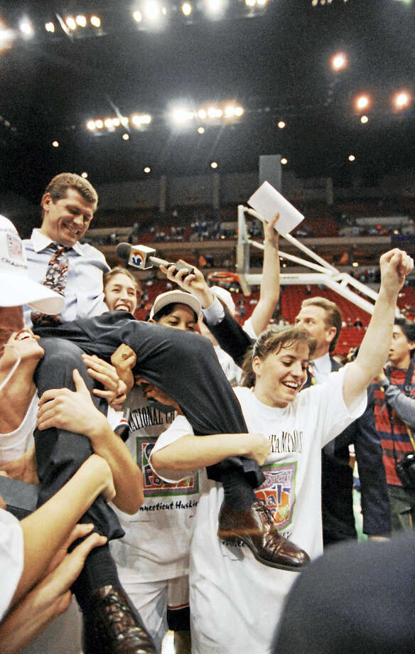 In this April 2, 1995, file photo, UConn coach Geno Auriemma, left, rides on the shoulders of his players after Connecticut beat Tennessee 70-64 to win the national championship. An in-depth documentary on that team will air on SNY on Wednesday. Photo: The Associated Press File Photo  / AP