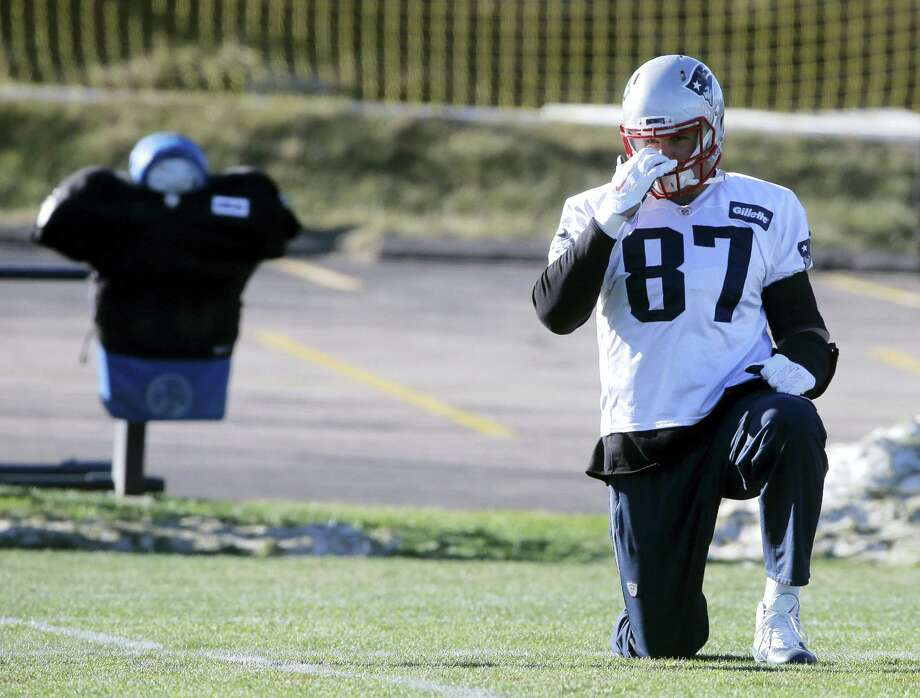 Patriots tight end Rob Gronkowski (87) warms up on the field during practice on Monday. Photo: Steven Senne — The Associated Press  / AP