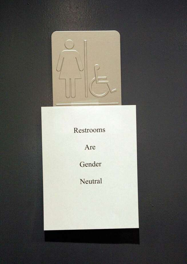 "A sign is posted at the entrance of the restrooms during the ""Transgender Day of Remembrance"" at the Metropolitan Community Church in West Hollywood. Photo: Hector Mata — Digital First Media File Photo  / 2006 AFP"