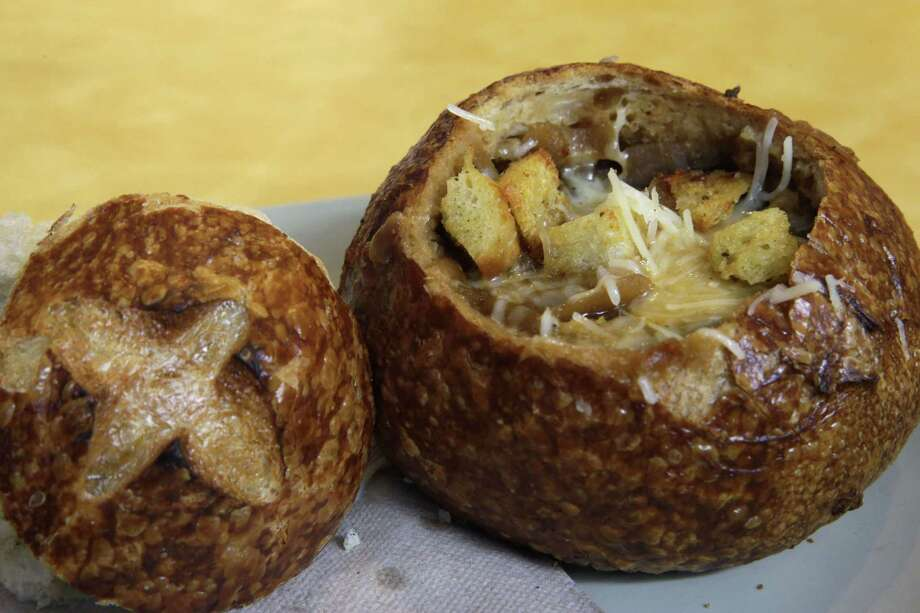 This June 9, 2015, file photo, shows a Bistro French Onion Soup Bread Bowl at a Panera bread restaurant in New York. The city Board of Health voted unanimously Wednesday, Sept. 9, to require chain eateries to put salt-shaker symbols on menus to denote dishes with more than the recommended daily limit of 2,300 milligrams of sodium. A Bistro French Onion Soup Bread Bowl contains more sodium than the recommended daily limit, which is equal to about 1 teaspoon of salt. Photo: AP Photo/Mary Altaffer, File  / AP