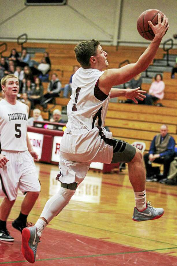 Torrington's Zak Mancini goes up strong for a layup in his team's non-conference win over Newtown Monday night. Photo: Marianne Killackey — For The Register Citizen  / 2015