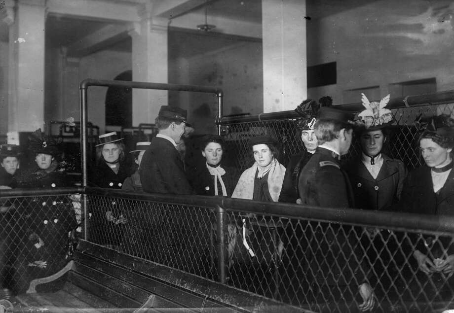 This photo made between 1907 and 1917 and made available by the Library of Congress shows immigrants at Ellis Island, New York. Photo: George Grantham Bain Collection/Library Of Congress Via AP   / George Grantham Bain Collection/Library of Congress