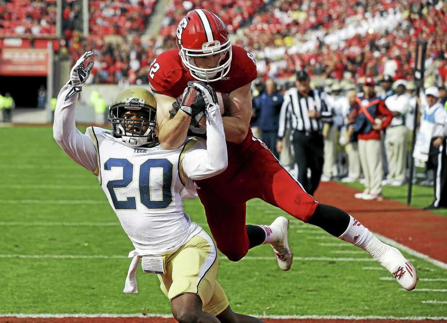 North Carolina State's Bo Hines and Georgia Tech's Lawrence Austin (20) battle for a pass intended for Hines during a Nov. 8, 2014 game in Raleigh, N.C. Photo: Gerry Broome — The Associated Press File Photo  / AP