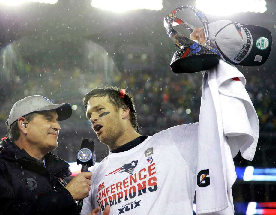 New England Patriots quarterback Tom Brady, right, holds the AFC championship trophy while being interviewed by Jim Nantz after a 45-7 win over the Indianapolis Colts on Jan. 18 in Foxborough, Mass. Photo: Matt Slocum — The Associated Press  / AP