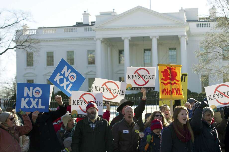 Dozens of demonstrators rally in support of Obama's pledge to veto any legislation approving the Keystone XL pipeline, outside the White House in Washington on Saturday. Photo: AP Photo  / FR159526 AP