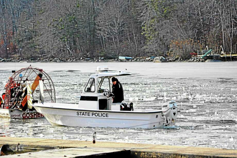 An airboat from Goshen Fire Department breaks up ice on West Hill Pond so a state police boat could search the area for a missing kayaker. Photo: Kaitlin McCallum -- The Register Citizen