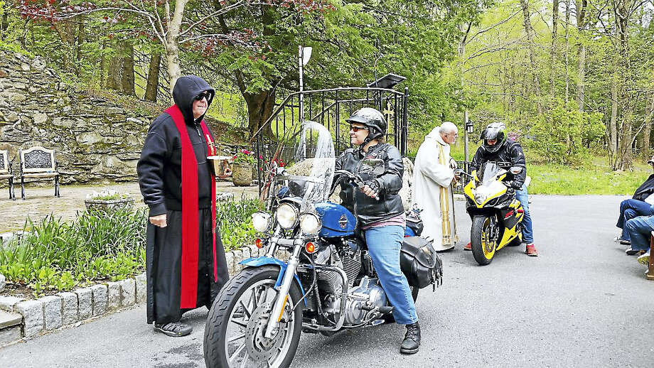 N.F. Ambery photo A motorcyclist is blessed by the Rev. Robert Tucker of St. Anthony of Padua of Litchfield as the Rev. Bill Considine of Our Lady of Lourdes blesses another cyclist at right. Photo: Journal Register Co.