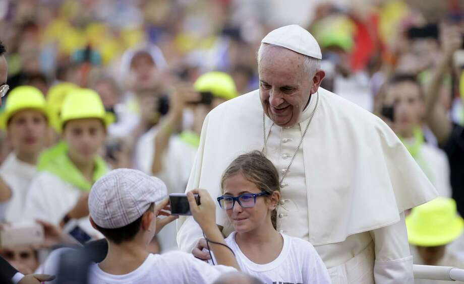 In this Aug. 4, 2015 photo, Pope Francis poses for a photo as he arrives in St. Peter's Square at the Vatican for an audience with with Altar boys and girls. Photo: AP Photo/Gregorio Borgia, File  / AP