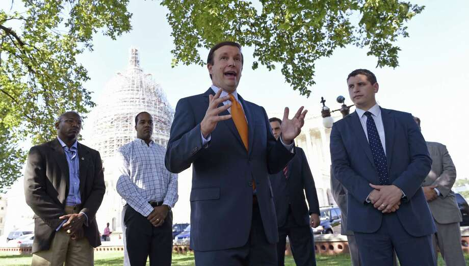 Sen. Christopher Murphy, D-Conn., center, speaks about the Iran nuclear deal on Capitol Hill in Washington on Sept. 8, 2015, as he stands with Truman Project Executive Director Michael Breen, right, and other veterans. Murphy supports the Iran nuclear deal. Photo: AP Photo/Susan Walsh  / AP
