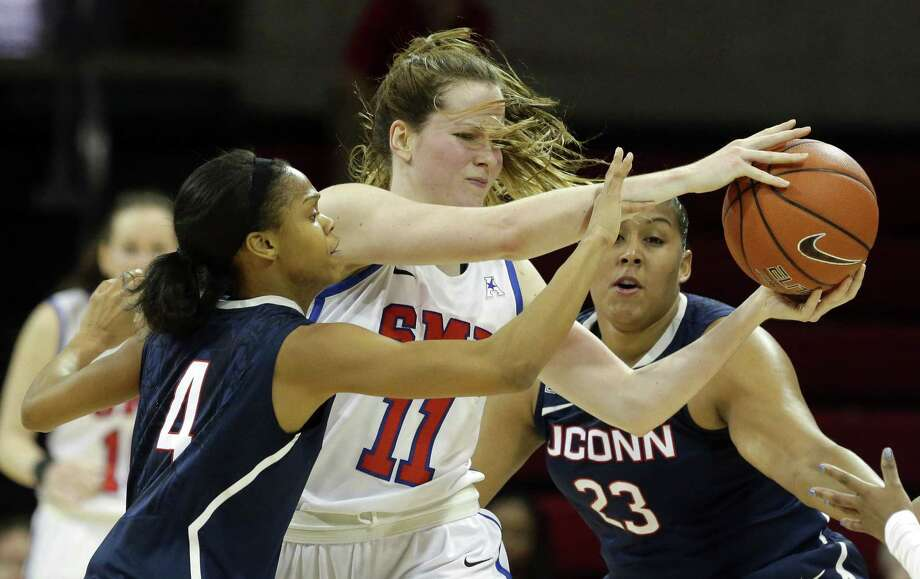 SMU forward Keely Froling (11) is defended by UConn's Moriah Jefferson (4) and forward Kaleena Mosqueda-Lewis (23) during the first half Sunday. Photo: LM Otero — The Associated Press  / AP