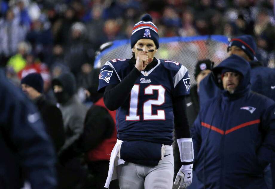 Quarterback Tom Brady and the Patriots rallied twice on Saturday to beat the Ravens. Photo: Elise Amendola — The Associated Press  / AP