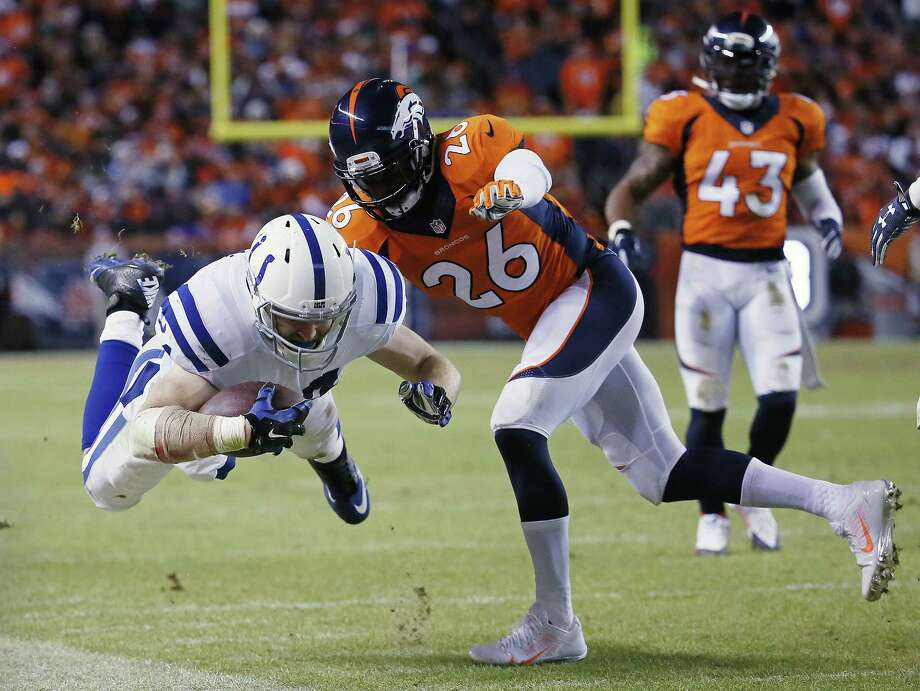Colts running back Ahmad Bradshaw is knocked out of bounds during the second half Sunday. Photo: Jack Dempsey — The Associated Press  / FR42408 AP