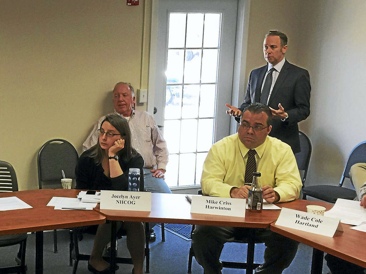 Michael Cicchetti of Frontier Communications details an offer to construct a fiber optic network in interested regional towns last week, while speaking with the Northwest Hills Council of Governments.
