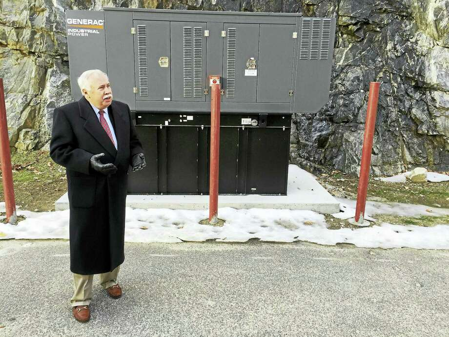Northwest Senior Housing Corporation president Larry Hannafin speaks Monday, as a newly-installed generator at the Susan M.B. Perry Senior Housing complex is celebrated. Photo: BEN LAMBERT — The Register Citizen