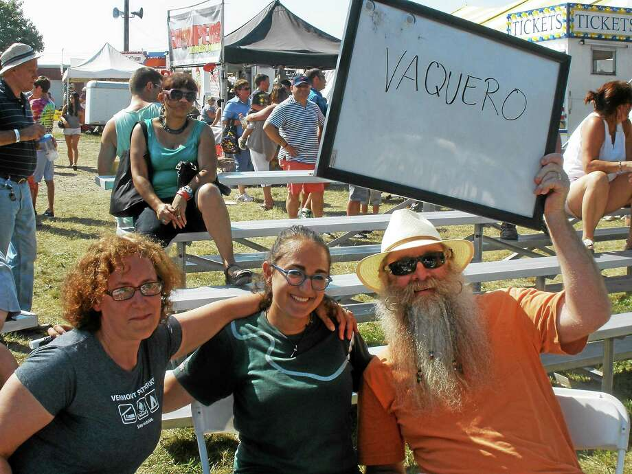 Deborah Griesbach, Maya Ghose and David Griesbach hold up their whiteboard with the word V-A-Q-U-E-R-O that clinched their victory in the Adult Spelling Bee at the Goshen Fair this weekend. Photo: Photo By Stephen Underwood