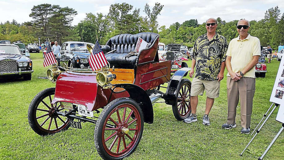 Dave and Jack Fairty of Norfolk exhibited their restored red 1904 Northern horseless carriage that had been passed down generations in their family. The vehicle, the third of its kind to have been driven in town, was among 98 entries at the fourth annual Norfolk Car Show at the Yale School of Music Shed in Norfolk on Saturday afternoon. Photo: Photo By N.F. Ambery