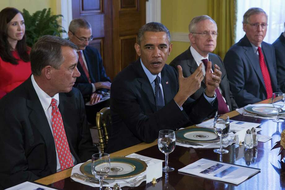 In this Nov. 7, 2014 photo, President Barack Obama meets with Congressional leaders in the Old Family Dining Room of the White House in Washington. From left are: House Speaker John Boehner of Ohio, Obama, Senate Majority Leader Harry Reid of Nev., and Senate Minority Leader Mitch McConnell of Ky. Photo: AP Photo/Evan Vucci, File  / AP