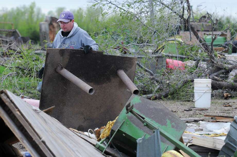 James Fink surveys the damage to family friend Mike Fechner's farm on May 10, 2015 near Delmont, S.D., after a tornado tore through the area damaging homes and businesses on Sunday morning. Photo: Joe Ahlquist/The Argus Leader Via AP  / Argus Leader