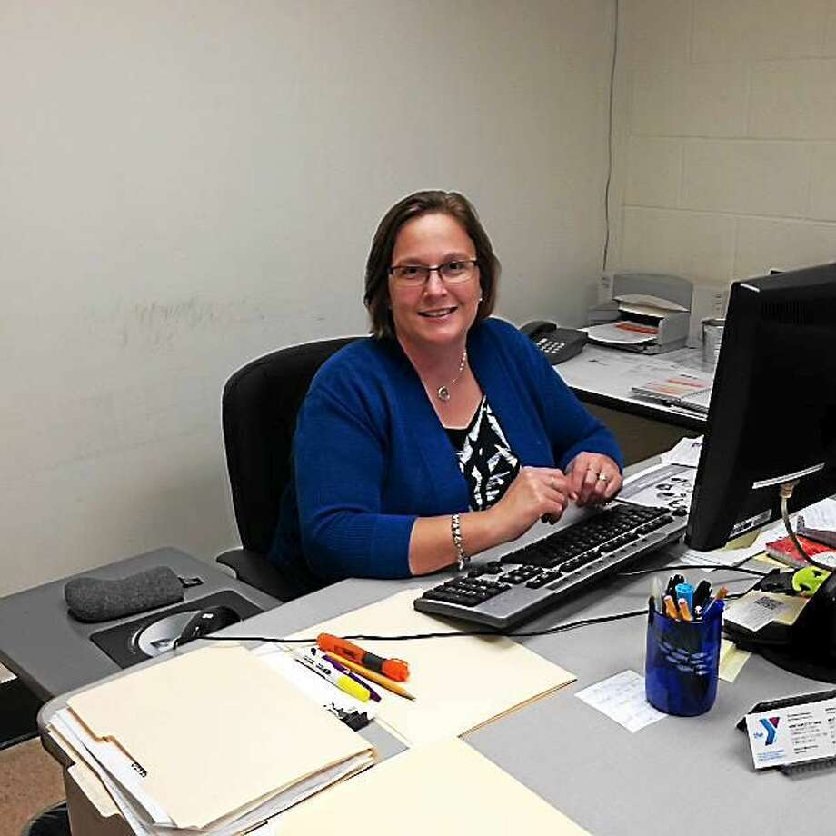 Development Director Yvonne Johnson sits behind her new desk at the Torrington YMCA. Photo: Amanda Webster — The Register Citizen