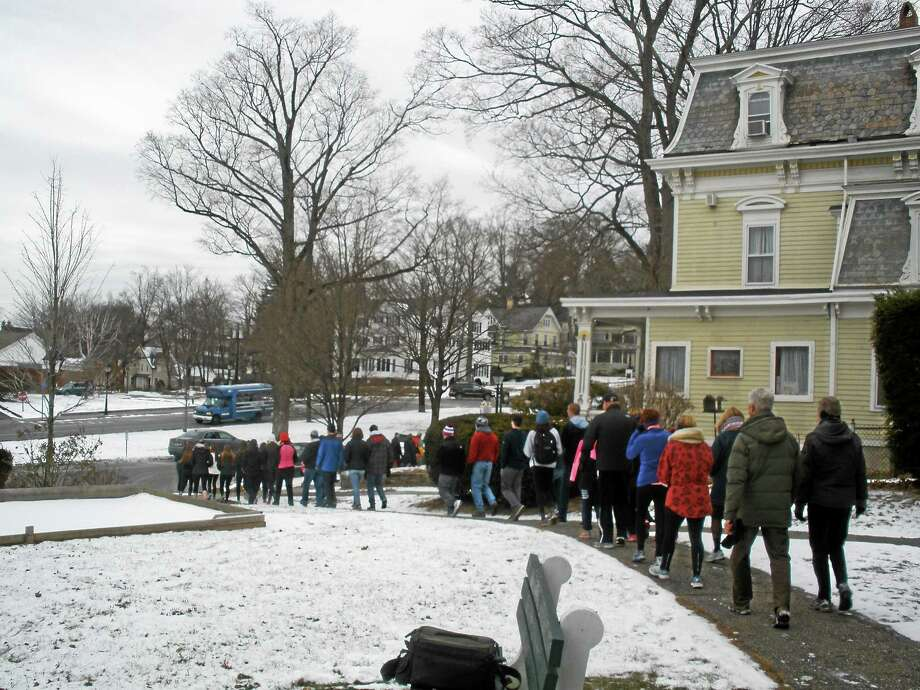 Walkers file their way out of the New Milford Senior Center to begin the fourth annual Cold Homes, Warm Hearts 5k Walk on Sunday. Photo: Stephen Underwood — Special To The Register Citizen