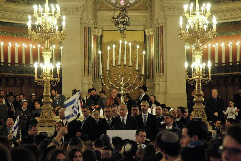 Israel's Prime Minister Benjamin Netanyahu, center, gives a speech during a ceremony at the Grand Synagogue in Paris, France, for all the victims of the attacks in Paris this week, which claimed 17 lives, Sunday, Jan. 11, 2015.  More than 40 world leaders, their arms linked, marched through Paris Sunday to rally for unity and freedom of expression and to honor 17 victims of three days of terrorist attacks. (AP Photo/Matthieu Alexandre, Pool) Photo: AP / AFP PHOTO