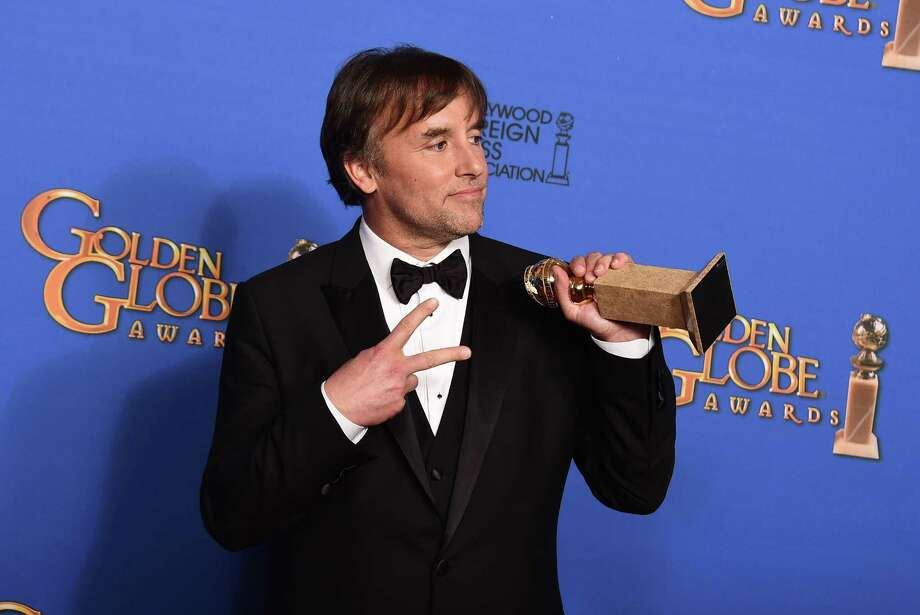 Richard Linklater poses in the press room with the award for best director for ìBoyhoodî at the 72nd annual Golden Globe Awards at the Beverly Hilton Hotel on Sunday, Jan. 11, 2015, in Beverly Hills, Calif. Photo: Photo By Jordan Strauss/Invision/AP  / Invision