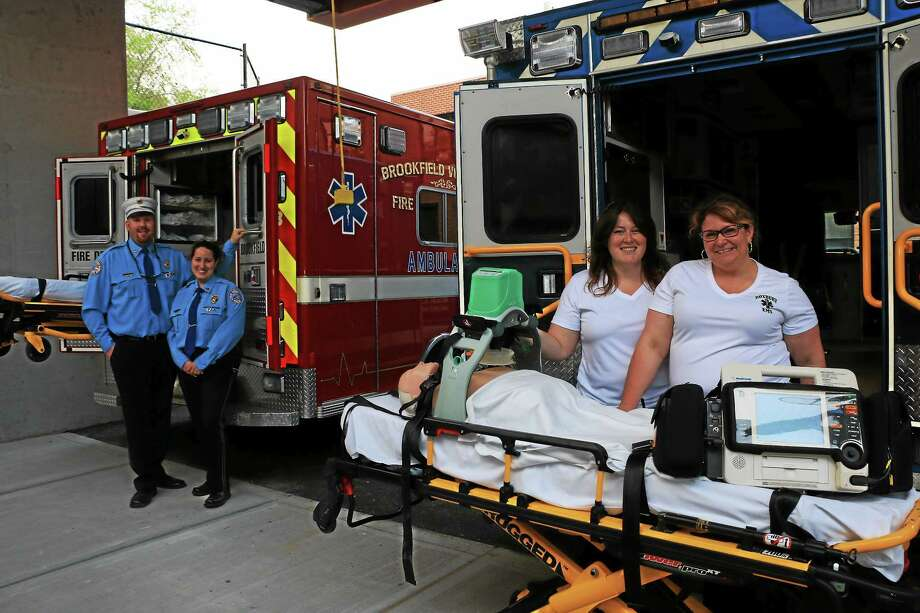 At the ambulance enterance for New Milford Hospitalís Arnhold Emergency Department are  Brian and Jessica Gallagher of the Brookfield Fire Company and Jennifer Luna and Sarah Lauriat of Roxbury Volunteer ambulance. Photo: Photo By John Fitts