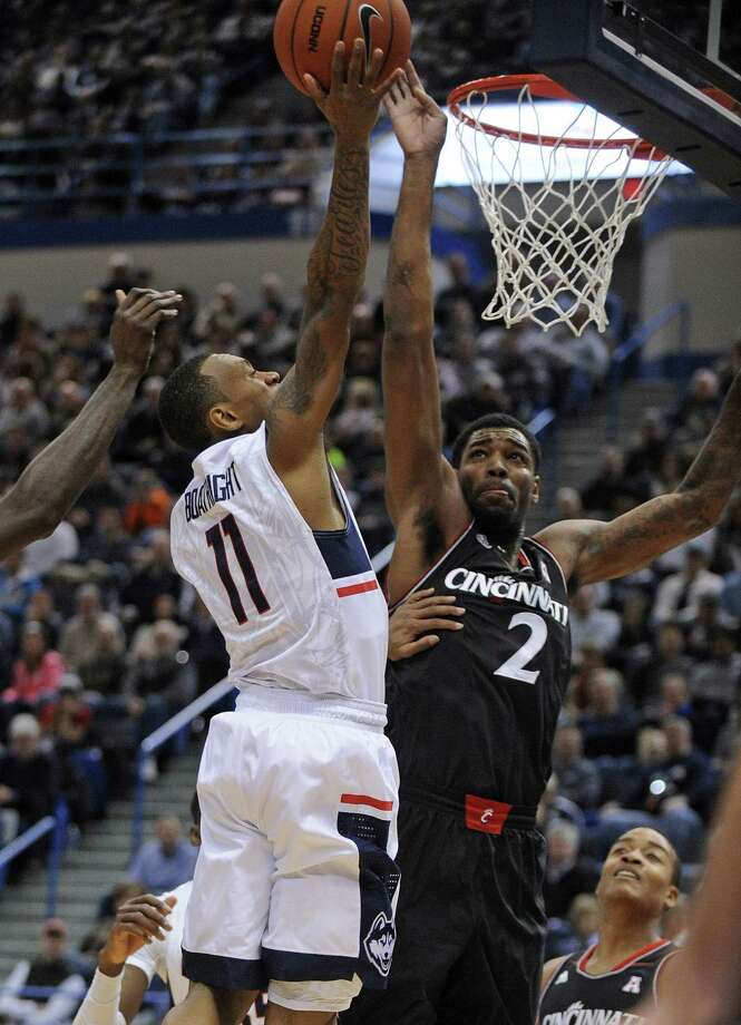 UConn's Ryan Boatright drives past Cincinnati's Octavius Ellis during the first half of the Huskies' 62-56 win over Cincinnati on Saturday at the XL Center in Hartford. Photo: Fred Beckham — The Associated Press  / FR153656 AP