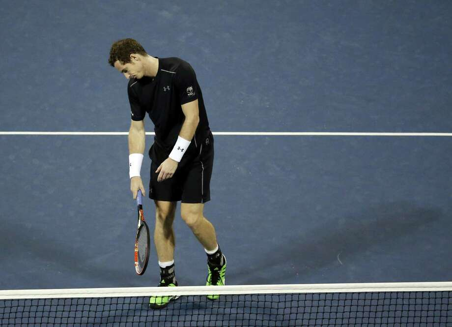 Andy Murray reacts after losing a point to Kevin Anderson during the fourth round of the U.S. Open on Monday in New York. Photo: Jason DeCrow — The Associated Press  / FR103966 AP